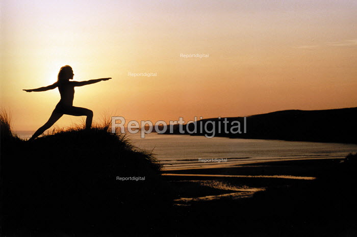 Yoga at Dawn, Freshwater West, Pembrokeshire. South Wales. - Paul Box - 2002-07-14