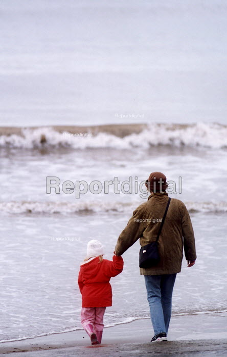 Mother and child walking on Pendine Beach foreshore, Pembrokeshire. South Wales. - Paul Box - 2002-09-14