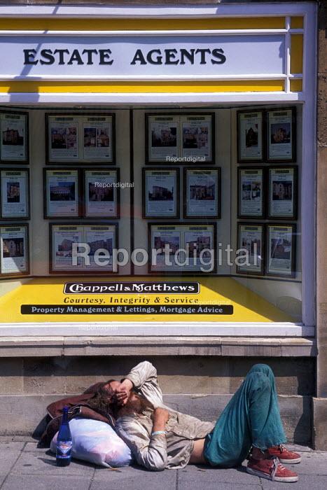 Homeless man lying down outside an Estate Agents shop, Bristol - Paul Box - 2003-08-14