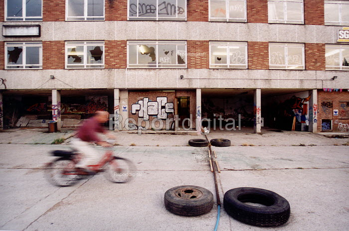 Teenager on a bike playing on Derelict industrial land St Werburghs Bristol - Paul Box - 2001-07-14