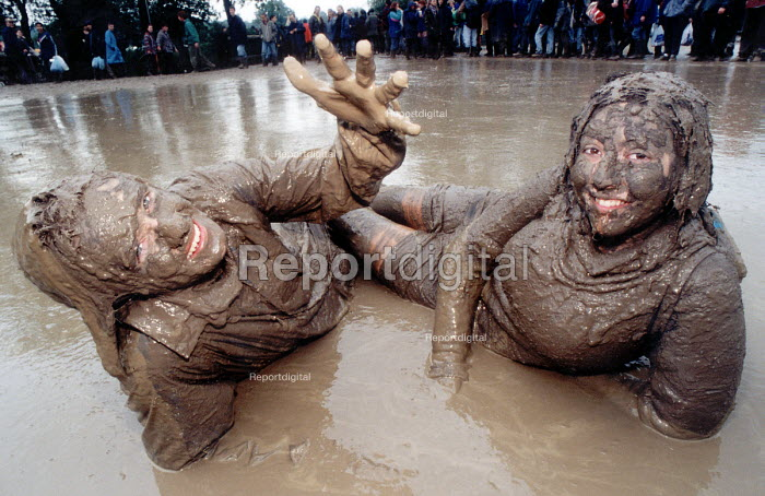 Students covered in the mud, Glastonbury Festival. - Paul Box - 2001-07-14