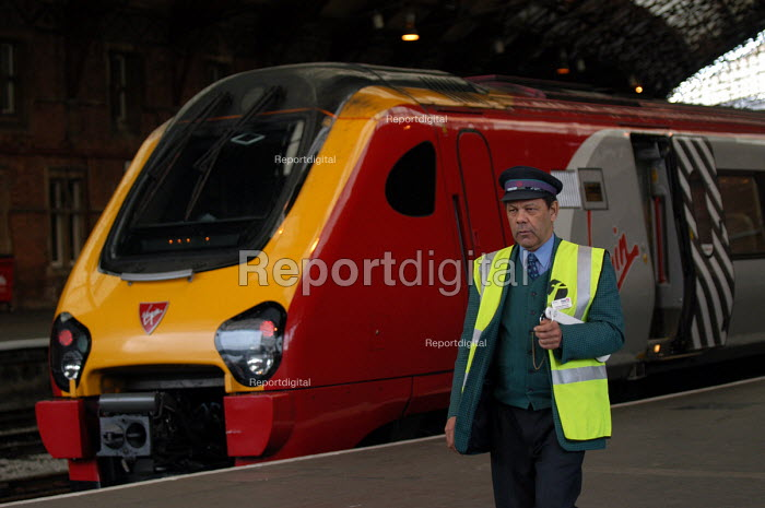 Virgin west coast employee on the platform at Bristol Temple Meads Railway Station - Paul Box - 2003-11-01