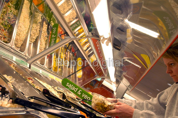 Customer self serves at salad bar Sainsburys supermarket - Paul Box - 2003-11-01