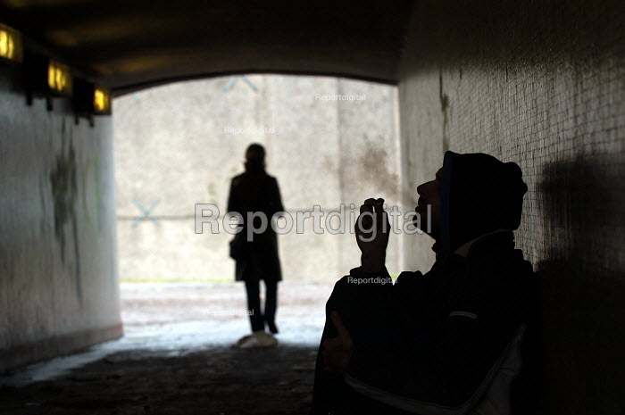 A beggar in underpass receiveing change from passing woman, Bristol - Paul Box - 2003-10-18