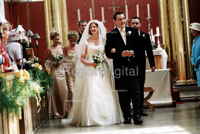 Bride and groom walk down the aisle at wedding in Essex - Paul Box - 2002-06-20