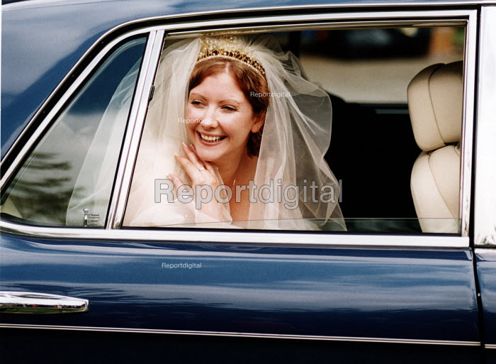 Bride arrives at her wedding ceremony in the wedding car, Essex - Paul Box - 2002-06-20