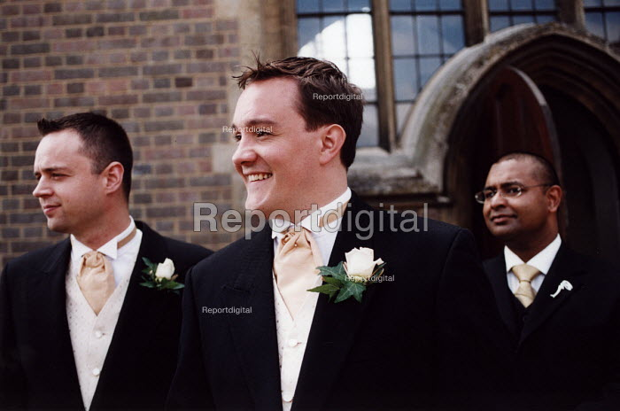 Groom and best man outside the church at wedding in Essex - Paul Box - 2002-06-20