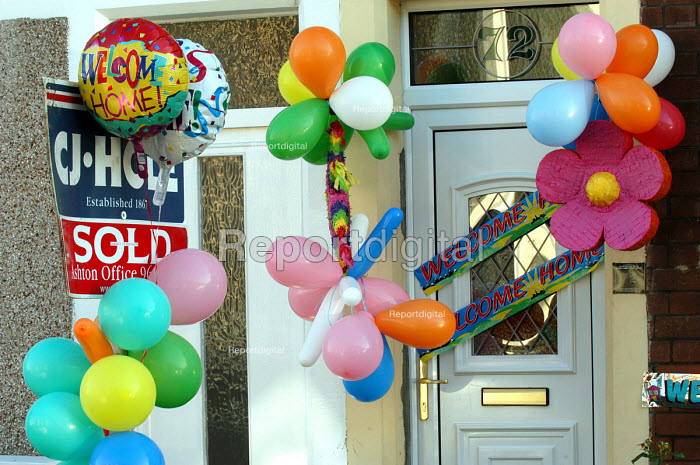 House with sold sign and welcome home balloons - Paul Box - 2003-11-01
