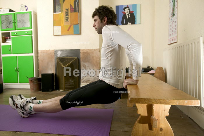 A man doing stretches, in preparation for cycling. - Paul Box - 2006-03-07