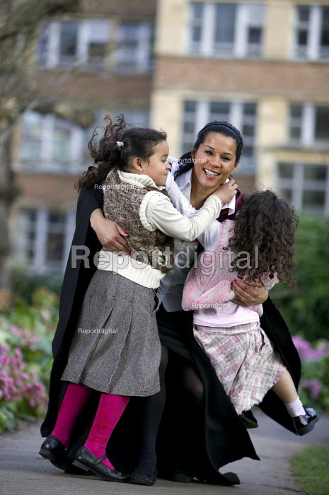 A student on Graduation Day at Bristol University, with her children. - Paul Box - 2007-03-14