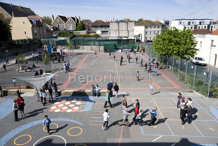 Children in the playground on their mid-morning breaktime, at Hillcrest Primary School, Bristol. - Paul Box - 2009-04-29
