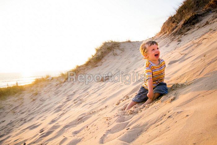 A toddler playing, Freshwater West beach, Pembrokeshire, Wales. - Paul Box - 2014-09-21