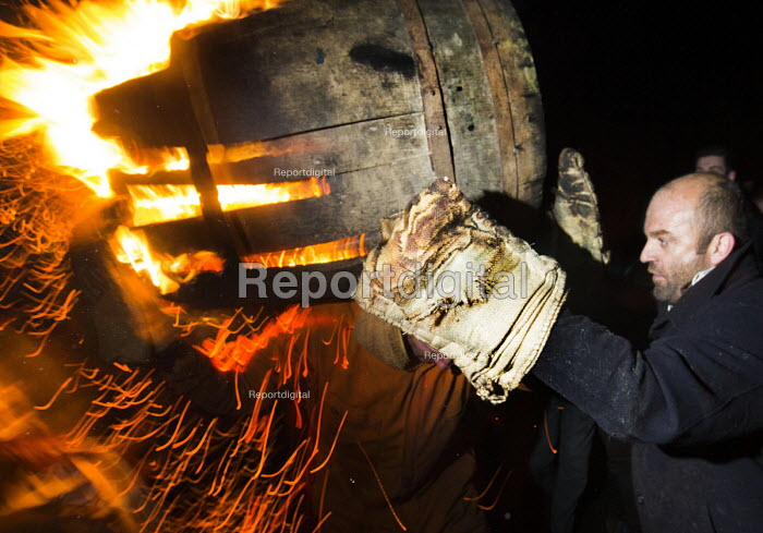 Flaming tar barrels are carried through the streets of Ottery St Mary, Devon. The barrels are covered in paraffin and lit. They are then carried on the backs of locals as they run through the streets. The tradition is hundreds of years old. - Paul Box - 2014-11-05