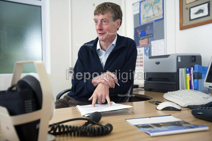 A GP talking to a patient in his surgery.NHS Southmead Health Centre, in Bristol. - Paul Box - 2009-09-02