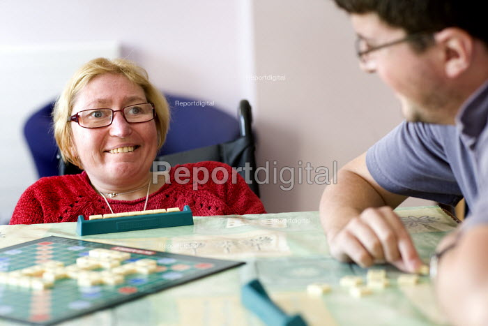 Housing residents playing scrabble. Selwood manage and maintain quality affordable housing and provide support services for people in housing need - Paul Box - 2009-07-30
