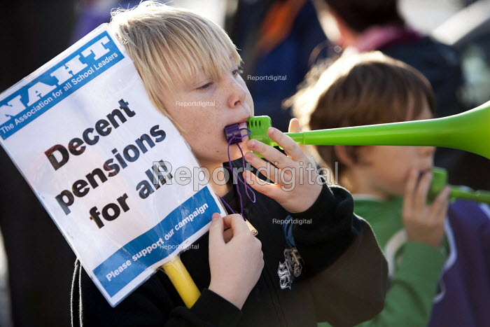 NAHT, boy blows a vuvuzela horn at the Strike by public sector workers over pensions. Cardiff, Wales. - Paul Box - 2011-11-30
