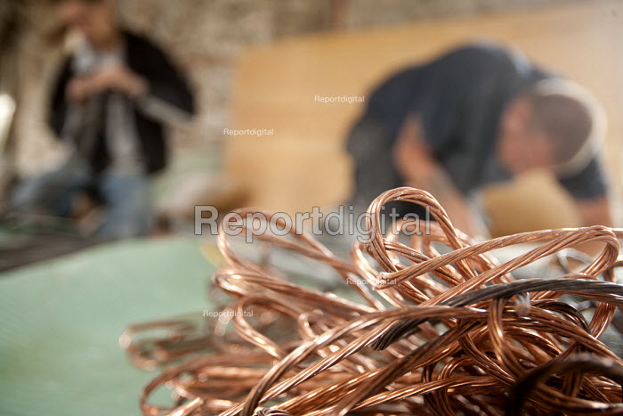 Workers on a building site stripping valuable copper electrical wire for scrap. - Paul Box - 2008-08-12