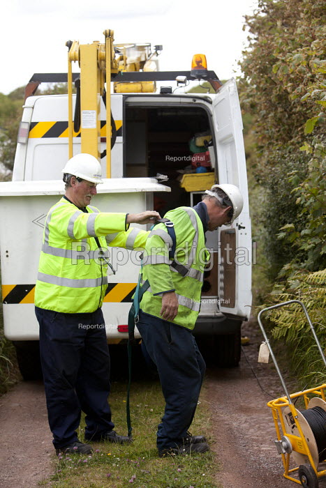 BT Openreach, installing a new telephone line to a telegraph pole using an access platform lift with an articulating flyboom, Pembrokeshire, Wales. - Paul Box - 2011-06-13
