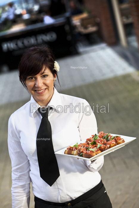 A waitress serving at a social event at Piccolino restaurant, Bristol. - Paul Box - 2011-08-17