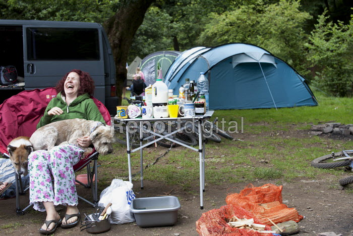 Woman playing with her dogs at Pool Farm Campsite, Porlock, Somerset. - Paul Box - 2011-08-09