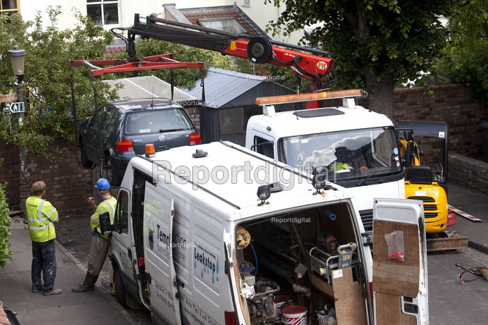 A car being removed to allow contractors to replace a leaking water pipe and install a water meter. Bristol. - Paul Box - 2011-06-27