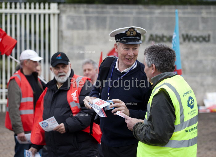 Navel officer taking a leaflet. UNITE and PCS pensions picket at MOD headquarters for procurement, Abbey Wood, Bristol. - Paul Box - 2012-05-10