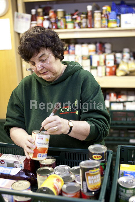 A volunteer in the warehouse sorting donated food at the Cardiff Foodbank, part of the Trussell Trust and the National Foodbank Network, which is set up to help and support those suffering hardship. - Paul Box - 2012-05-10
