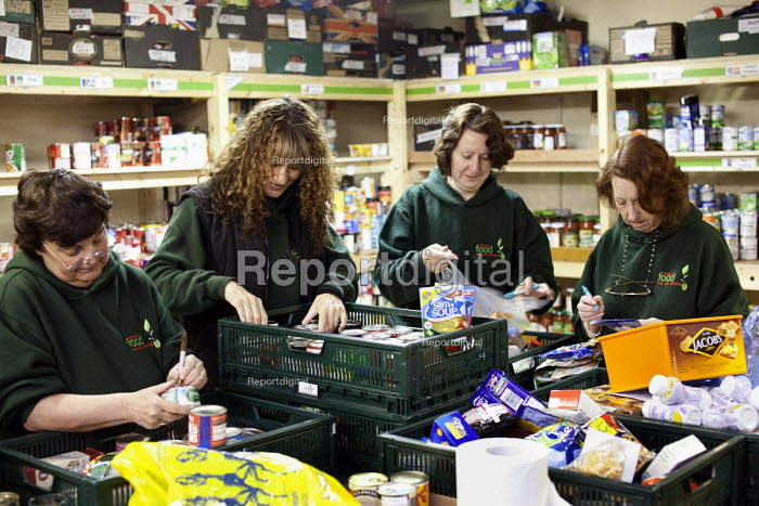 Volunteers in the warehouse sorting donated food at the Cardiff Foodbank, part of the Trussell Trust and the National Foodbank Network, which is set up to help and support those suffering hardship. - Paul Box - 2012-05-10