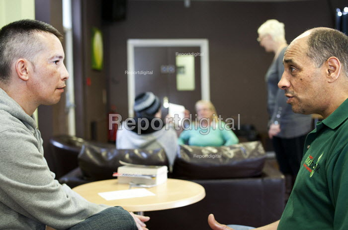 Volunteers talk with Foodbank users at the City Foodbank Centre. Cardiff Foodbank is part of the Trussell Trust and the National Foodbank Network. It is set up to help and support those suffering hardship. - Paul Box - 2012-05-10