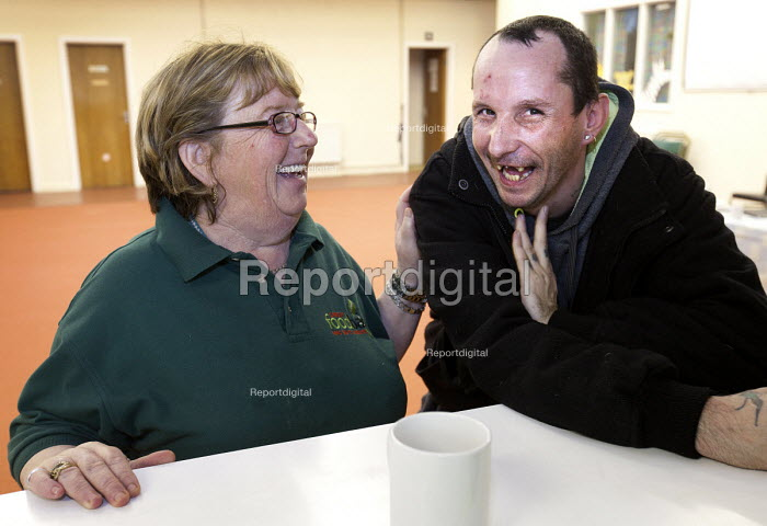 A volunteer has a laugh with a Foodbank user at the City Foodbank Centre. Cardiff Foodbank is part of the Trussell Trust and the National Foodbank Network. It is set up to help and support those suffering hardship. - Paul Box - 2012-05-10
