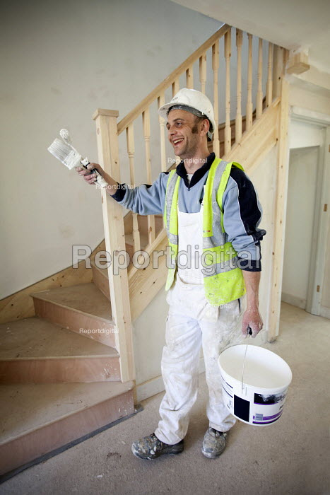 A painter and decorator working on new housing near Taunton, Somerset. - Paul Box - 2012-03-22