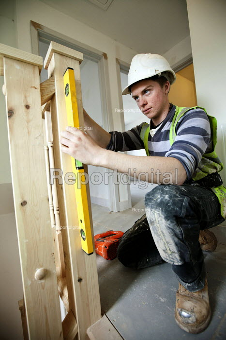 A carpenter fitting a bannister, new housing near Taunton, Somerset. - Paul Box - 2012-03-22