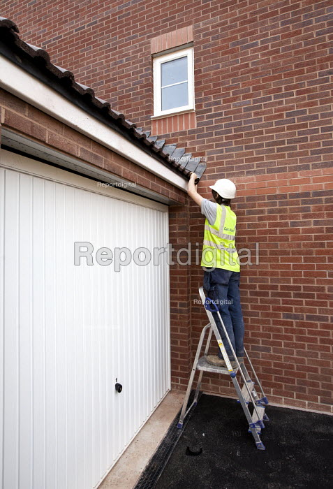 A plumbers apprentice working on new housing near Taunton, Somerset. - Paul Box - 2012-03-22