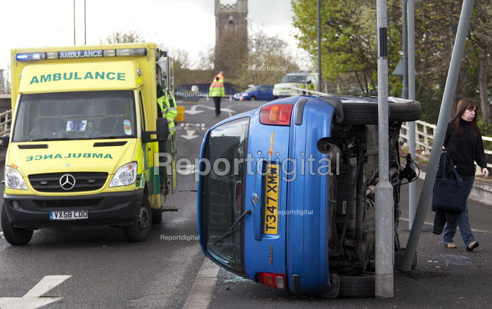 The driver of a car walks from the scene after a car crash, on the slip road of the M32, Bristol. - Paul Box - 2012-04-18
