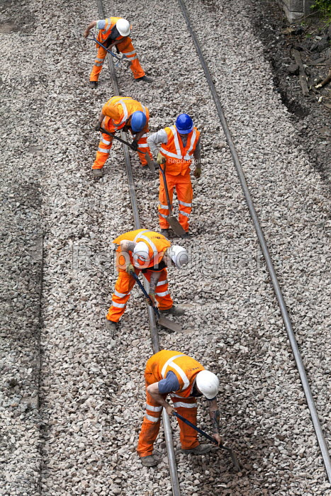 A gang of agency workers shovelling track ballast. Portishead to Bristol freight line being upgraded. - Paul Box - 2012-05-20