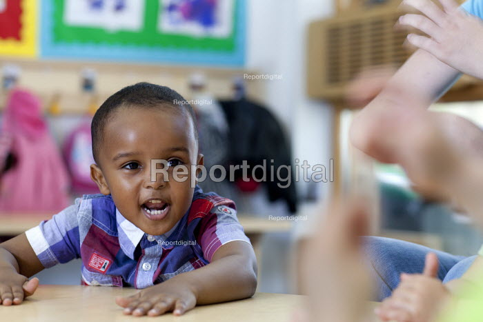 Singing songs. Children at Barton Hill Childrens Centre, Bristol. childcare and early learning services for children under 5 years old. - Paul Box - 2012-05-25