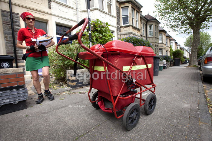 A postwoman on her delivery round Bristol with her high capacity trolley. Bristol - Paul Box - 2012-06-01