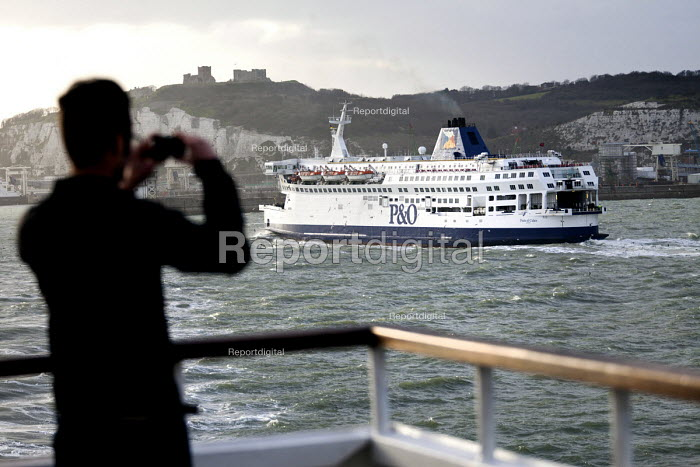 A passenger takes pictures of a P&O ferry arriving in Dover, DFDS Seaways ferry crossing the Channel from Dover UK to Dunkirk, France. - Paul Box - 2012-03-31