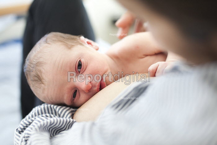 A new born baby sleeps with his mother. The mother is an... - Paul Box, PB1303147.JPG
