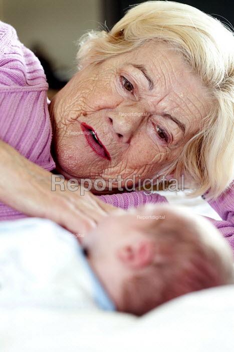 A grandmother cuddles her new grandson. - Paul Box - 2012-09-28