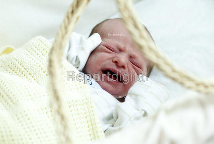 A baby boy screams in his moses basket. Bristol - Paul Box - 2012-09-29
