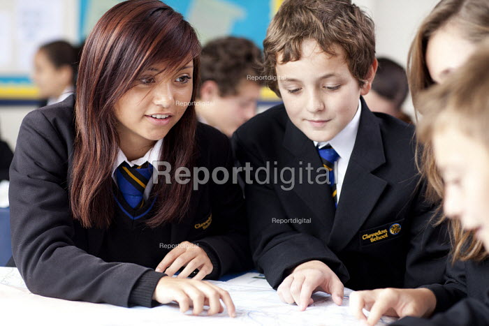 Pupils helping each other in a Geography lesson, looking a maps, Clevedon school, Clevedon - Paul Box - 2011-09-13