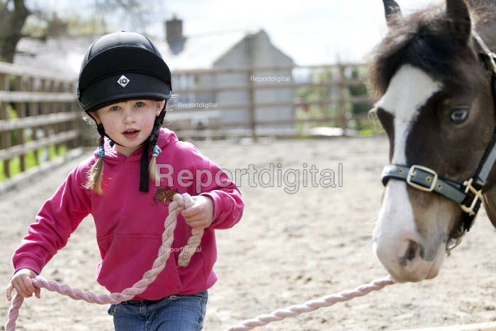 A 4 year old girl leads her pony, Wrexham, Wales - Paul Box - 2012-04-28