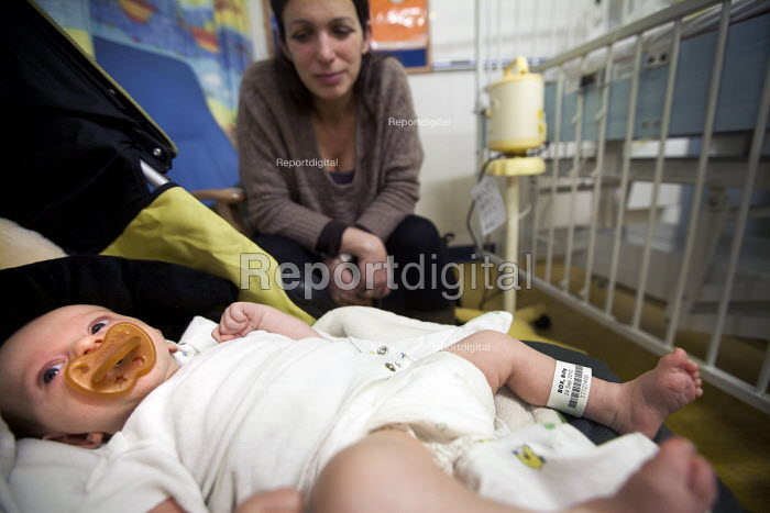 A 6 week old baby boy waits for an operation for an Inguinal hernia, Bristol Children's hospital, Bristol. - Paul Box - 2012-11-07