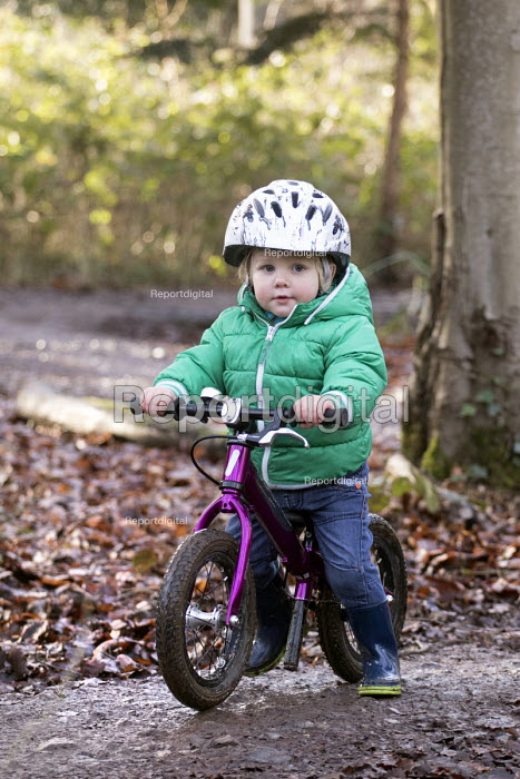 Two 2 year old boys on their balance bikes, Leigh Woods, Bristol - Paul Box - 2015-01-24