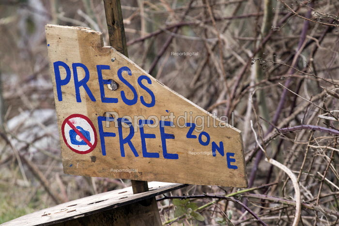 Press free zone sign showing their hostility to the press and media. Protesters camp in trees to stop them being cut down. and Stapleton allotments from the Metrobus a controversial new bus lane, Bristol. - Paul Box - 2015-02-02