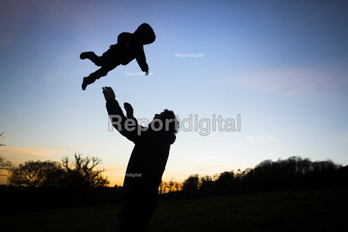 A father throwing his son up into the air, Ashton Court Estate, Bristol. - Paul Box - 2014-11-24
