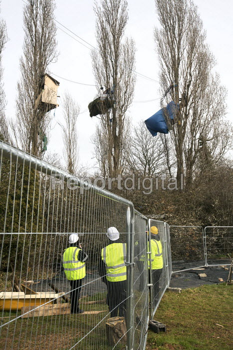Bailiffs and security gards move in to evict Stapleton Allotment tree-top protesters, Bristol. The protesters are objecting to the building on allotments and cutting down of trees for the MetroBus. - Paul Box - 2015-03-12