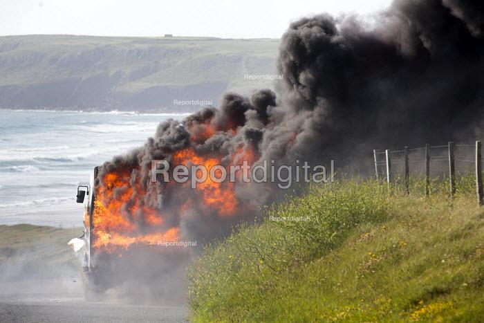 The Pembrokeshire Coastal Cruiser tourist passenger bus bursting into flames, Freshwater West, Wales - Paul Box - 2015-06-26