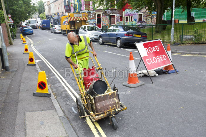 Residents protesting at new resident parking scheme, St Pauls, Bristol. Sub contractors painting double yellow lines. No parking cones on the street - Paul Box - 2015-06-17